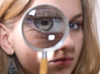 bigstock-Girl-looking-into-magnifying-g-26352443